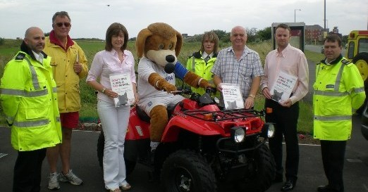 Leah Fraser, Me and Cllr Ian Lewis pictured with 'Rover' the dog and members of the Council's Enforcement Team at Moreton Shore