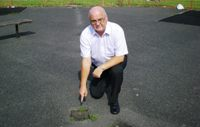 Cllr Blakeley with an open grid in the Park
