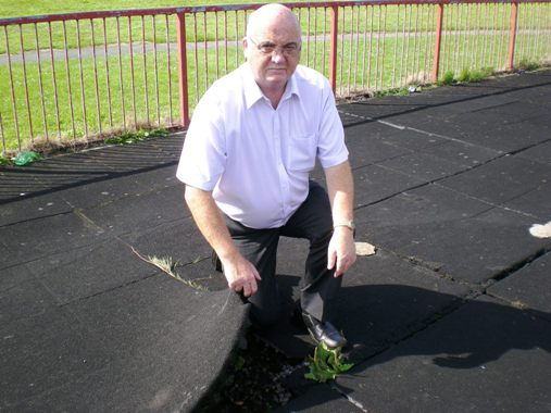 Cllr Blakeley at the Play Area with the damaged matting