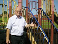 Cllr Blakeley at the rusty slide