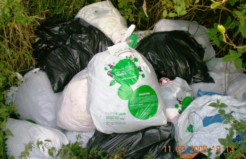 Web Clothes Aid Bags dumped in ditch